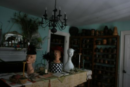 Antique hat molds and manequins create a visual paradise in Leigh's studio