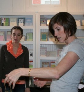 Amy Murphy of Mac & Murpy studies the necklaces