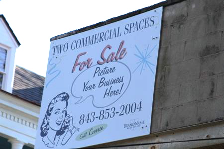 My commercial real estate sign hanging on 103 Spring St
