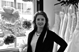 Della MacNicholas of the Wedding Row Event Blog poses in her first shop on Spring St